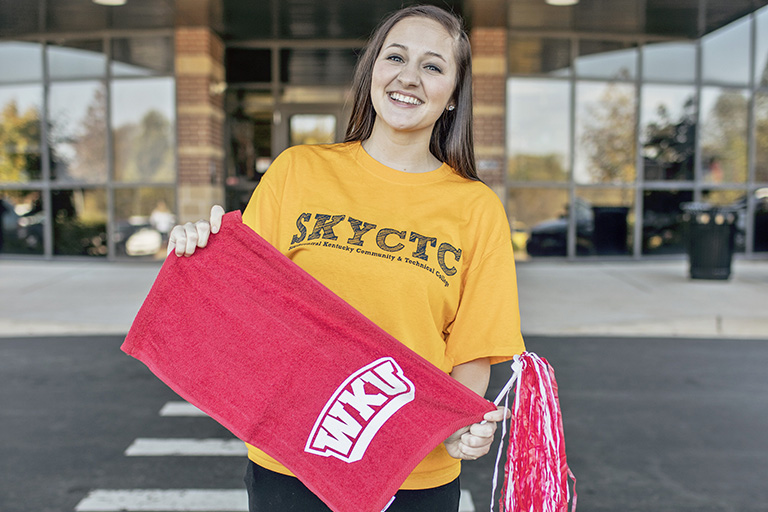 Girl in SKYCTC shirt holding WKU towel