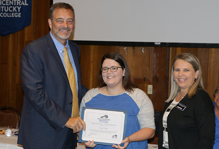 Glasgow Health Campus nursing student Kayla Miller (center) receives the Presidential Scholarship at this year's Glasgow/Barren County Industry Appreciation breakfast held Friday, September 13, 2019 at the Barren Rivers State Lodge. Presenting the scholarship was SKYCTC President, Dr. Phil Neal (left) and Angie Harlan, Dean of Allied Health and Nursing (right). Also receiving the Presidential Scholarship was Mark White of Nemak Industries who could not be present at the breakfast.