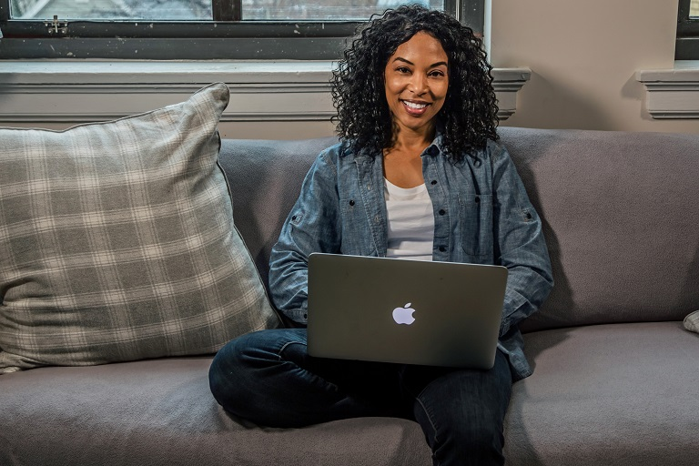 woman on couch with a laptop