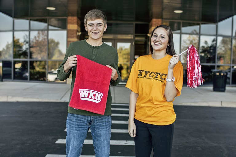 Guy and girl holding WKU towel and pom pom
