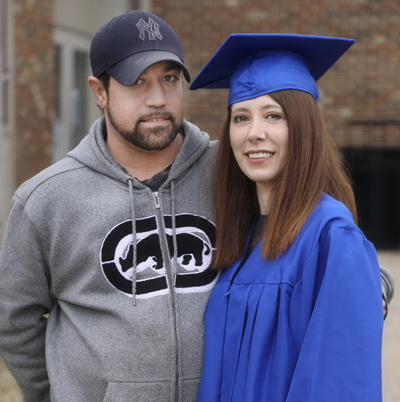 Heather Klumb in her cap and gown with husband