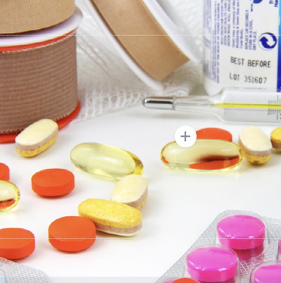 Photo of various medications laying o a table
