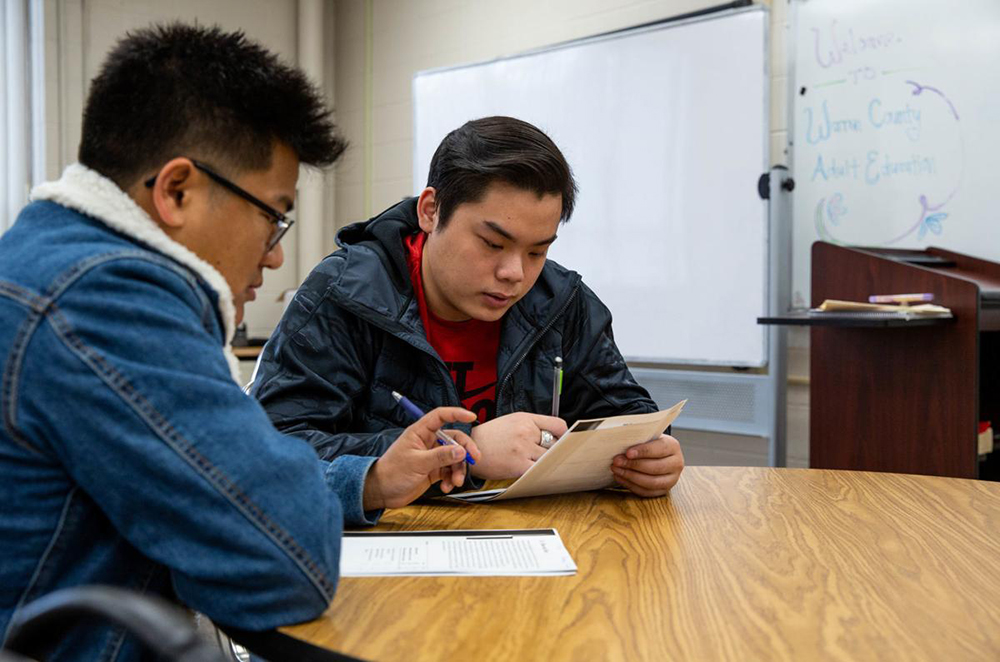 Southcentral Kentucky Community and Technical College Ged students James Thang and Quang Le work on a reading assignment in GED Teacher Debbie Fox's advanced language arts class at SKYCTC on Thursday, Jan 9, 2020. Earlier this week, the Brashear administration announced it will be waiving testing fees for Kentuckians seeking to earn a Ged. (Grace Ramey/photo@bgdailynews.com)