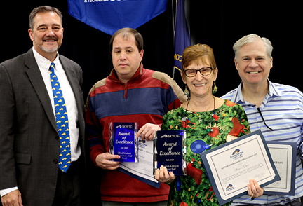 Dr. Phil Neal, President of SKYCTC presents awards of excellence to Chad Lindsey, Sharon Gibson, and Kevin Kenady