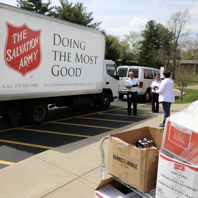 Photo of people loading boxes of food onto Salvation Army truck