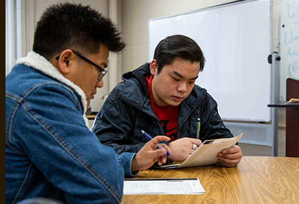 Two men studying for their GED exam - photo by Grace Ramey - BG Daily News