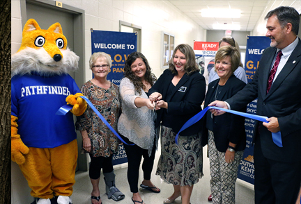 Members of Southcentral Kentucky Community and Technical College staff nad administration as well as community partners cut a ribbon for the grand opening of the new G.R.O.W. Center at teh College