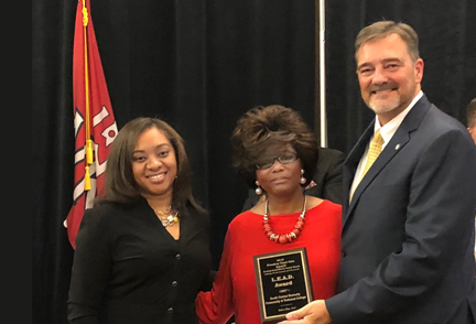 SKYCTC representatives Dr. Phillip Neal and Brooke Justice receive award from NAACP representative