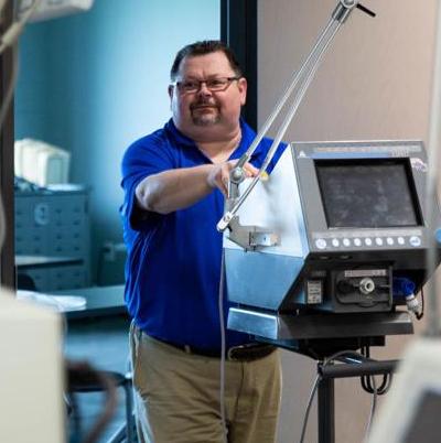 Ken McKinney helps load donated espiratord to the Medical Center van