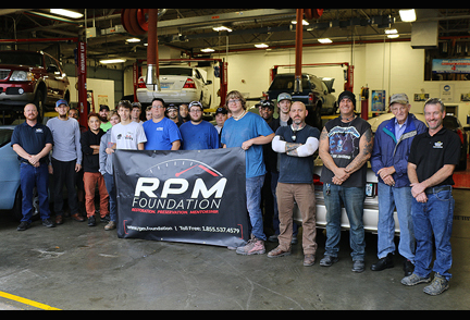 SKYCTC Collision Repair Student holding RPM banner