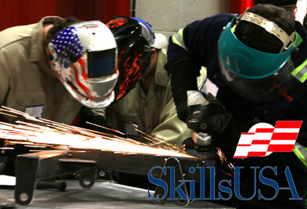 A team of high school welders welding a project