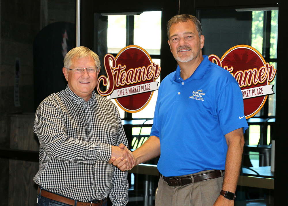 Seamers owner Dale Augenstein left and SKYCTC President, Dr. Phillip Neal, shake hands in renual of partnership