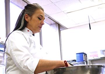 Tina Barron mixes ingredients in a bowl